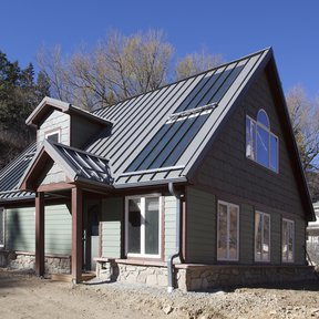 "<div><h4>McElroy Metal Medallion-Lok</h4><p><b>Manufacturer:</b> McElroy Metal, Inc.</p><p><b>Location:</b> Colorado, US</p><p><b>Style:</b> Vertical Panel/Standing Seam</p><p><b>Material:</b> Steel</p><p><b>Color:</b> Gray</p><p><a href=""/gallery/image-detail/571/"" class=""link-arrow text-uppercase theme-color--orange"" data-toggle=""modal"" data-target=""#detailModal_gallery_image_grid_lamlejqhdgHs"">View More</a></p></div>"
