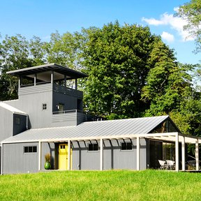 "<div><h4>Steel House, Guest House</h4><p><b>Manufacturer:</b> ATAS International</p><p><b>Style:</b> Vertical Panel/Standing Seam</p><p><b>Color:</b> Gray</p><p><a href=""/gallery/image-detail/33/"" class=""link-arrow text-uppercase theme-color--orange"" data-toggle=""modal"" data-target=""#detailModal_gallery_image_grid_lamlejqhdgHs"">View More</a></p></div>"